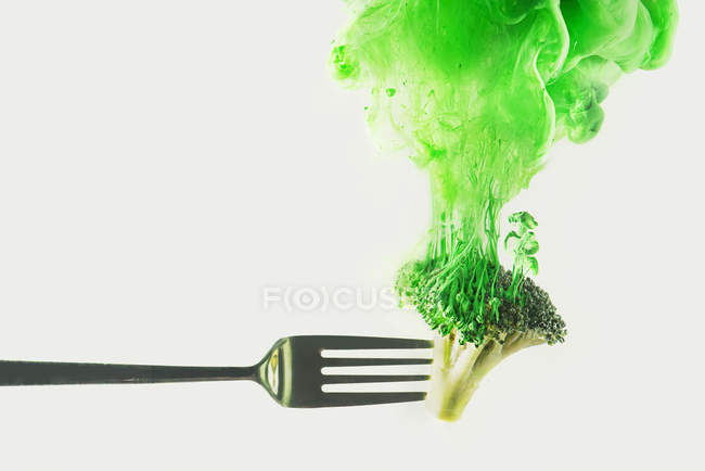 Broccoli on fork on white — Stock Photo