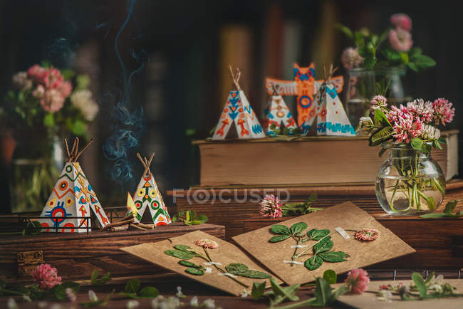 Paper wigwams on old retro books — Stock Photo