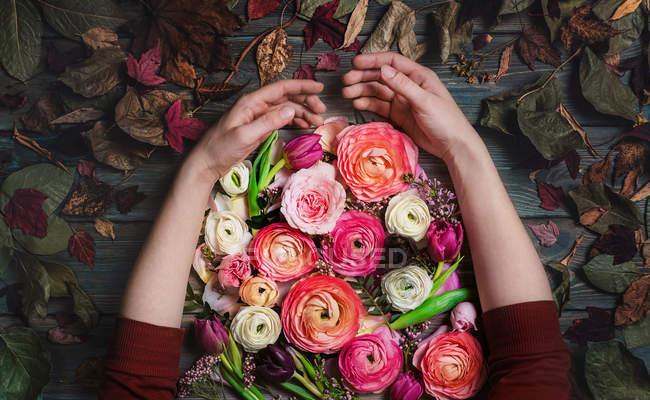 Female hands with flowers — Stock Photo