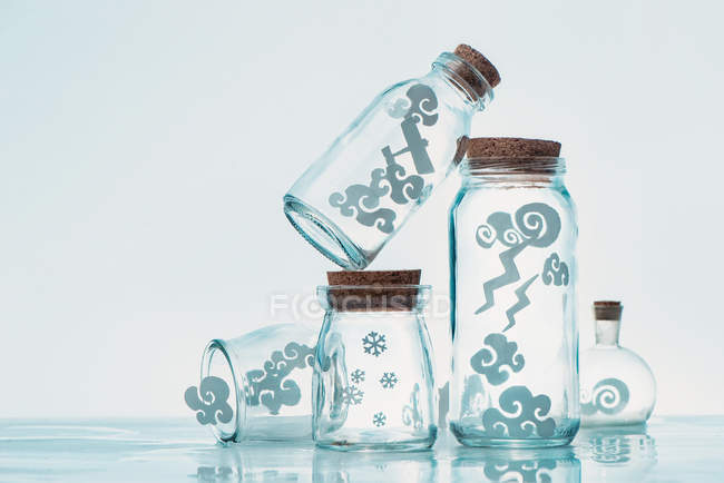 Paper clouds in jars — Stock Photo