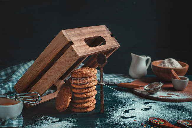 Cookies under a wooden box trap — Stock Photo