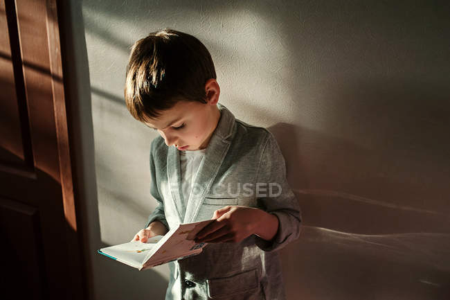 Little boy with book — Stock Photo
