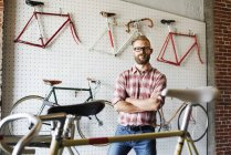 Portret of  man in bicycle shop. — Stock Photo