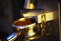 Fresh coffee grounds loaded into the cofee — Stock Photo