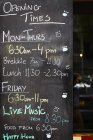 Chalk board with opening times — Stock Photo
