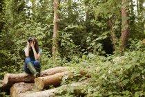 Young girl using binoculars. — Stock Photo