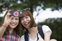 Japanese friends taking a selfie in the park. — Stock Photo