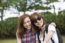 Two japanese women in the park. — Stock Photo