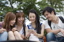 Japanese friends in the park. — Stock Photo