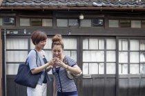 Japanese women standing outdoors — Stock Photo