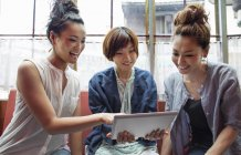 Japanese women looking at a digital tablet — Stock Photo