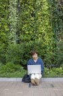 Asian woman with a laptop — Stock Photo