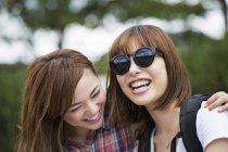 Two young women in the park. — Stock Photo