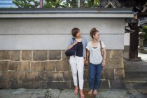 Two japanese women standing outdoors — Stock Photo