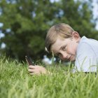 Boy using electronic games device. — Stock Photo