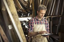 Furniture restorer in his workshop — Stock Photo