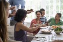 Family sharing a meal. — Stock Photo