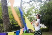 Woman in a Kyoto park — Stock Photo