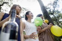 Friends at outdoor party in forest — Stock Photo