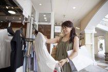 Woman looking at clothing — Stock Photo