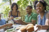 Family eating in a garden — Stock Photo