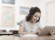 Girl using a digital tablet. — Stock Photo
