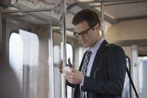 Businessman in a train carriage — Stock Photo