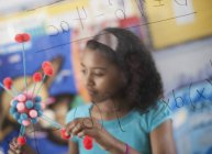 Girl holding a molecular structure — Stock Photo