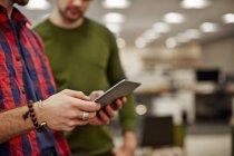 Men looking at a digital tablet — Stock Photo