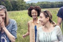 Women walking through a meadow — Stock Photo
