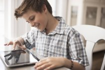 Boy using a digital tablet — Stock Photo