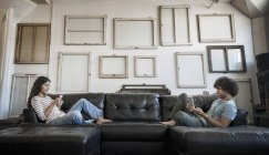 Couple sitting on the sofa — Stock Photo