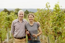 Couple, vineyard founder and her partner — Stock Photo