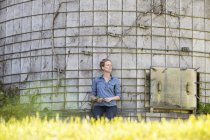 Woman taking a break near  silo — Stock Photo
