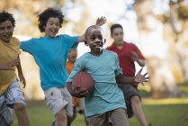 Children running with a ball. — Stock Photo