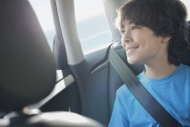 Boy sitting in a car — Stock Photo