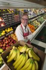 Man standing in a grocery shop — Stock Photo