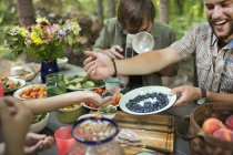 Friends gathered at a table outdoors — Stock Photo