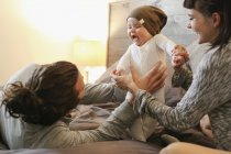 Mother, father and young baby together — Stock Photo