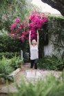 Woman doing yoga in a garden. — Stock Photo