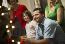 Adults and children in room around Christmas tree — Stock Photo