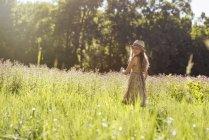 Girl walking in a field — Stock Photo