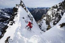 Skier skiing down — Stock Photo