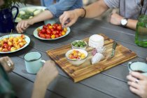 People gathered around a table — Stock Photo