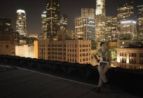Man on a rooftop at night — Stock Photo
