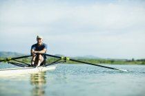 Man rowing a single scull boat — Stock Photo