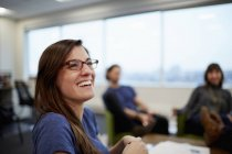 Woman laughing with her colleagues. — Stock Photo