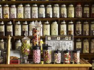 Traditional sweets in tall glass jars — Stock Photo