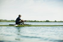 Man in a rowing boat on the water. — Stock Photo