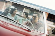 Friends in convertible car on a road trip. — Stock Photo